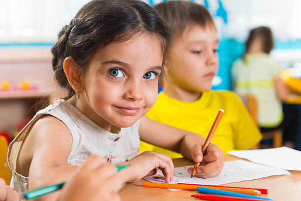 group of cute little prescool kids drawing - elementary age stock photos and pictures