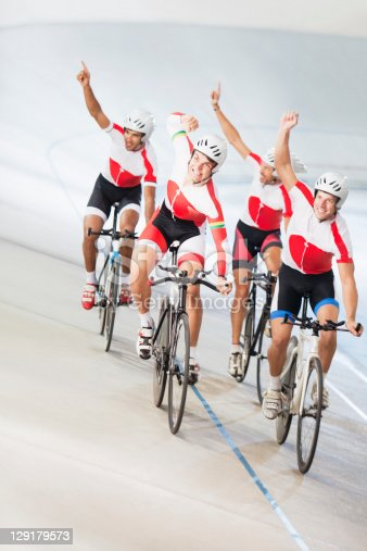istock Group of cyclists cheering 129179573