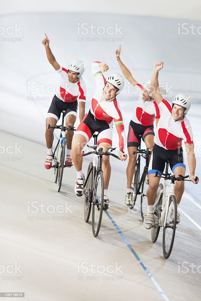 Group of cyclists cheering stock photo