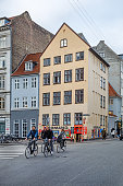 Copenhagen, Denmark, December 16, 2020. Group of young cyclists in front of an old house in the center of Copenhagen