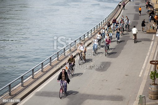 969439086 istock photo Group of cyclists on Paris 694184196
