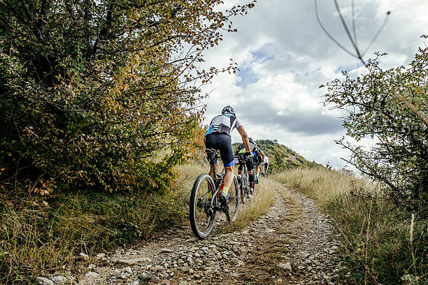 group of cyclists on sports mountainbike - foto de stock
