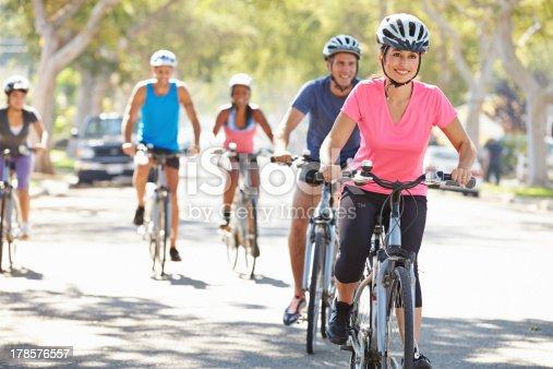istock Group Of Cyclists On Suburban Street 178576557