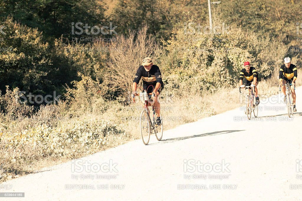 Group of cyclists on the road to Radda in Chianti stock photo