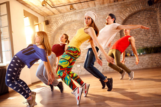 Group of dancers dancing together stock photo