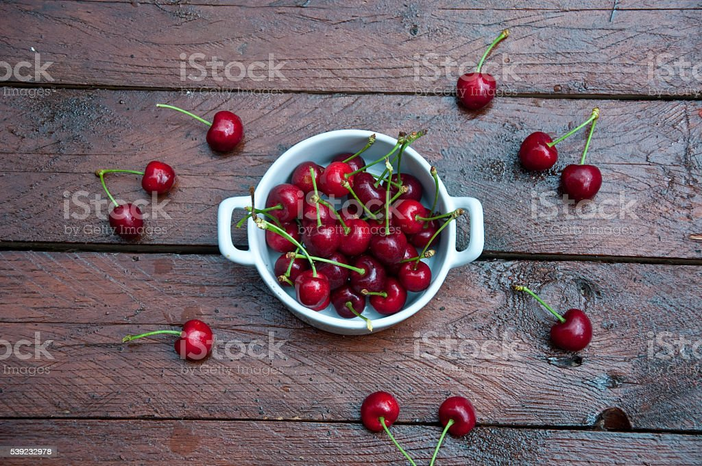 group of delicious freshly picked red cherries on wooden backgr royalty-free stock photo
