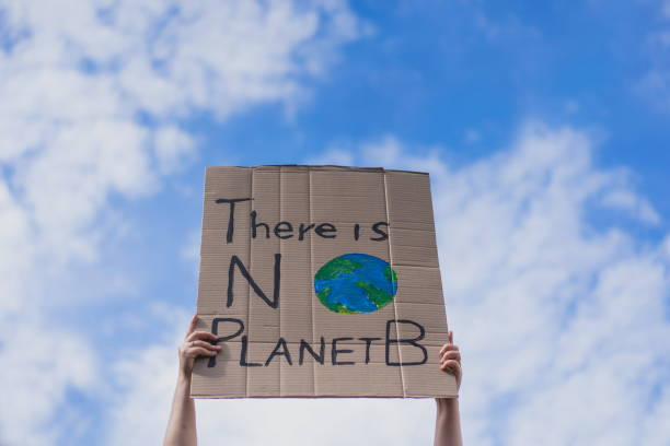 Group of demonstrators on road. Activists protesting on social issues. Race fight and climate change protesting activist during lockdown. global warming and environmental issues. Activists protesting on the street. Group of protestors race fight climate stock photo