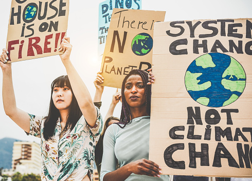 istock Group of demonstrators on road, young people from different culture and race fight for climate change - Global warming and enviroment concept - Focus on afro girl face 1152391424