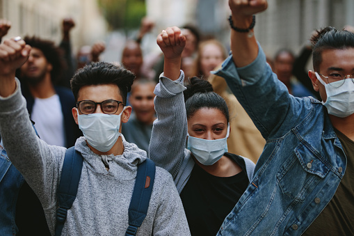 Group Of Demonstrators Protesting In The City Stock Photo - Download Image Now