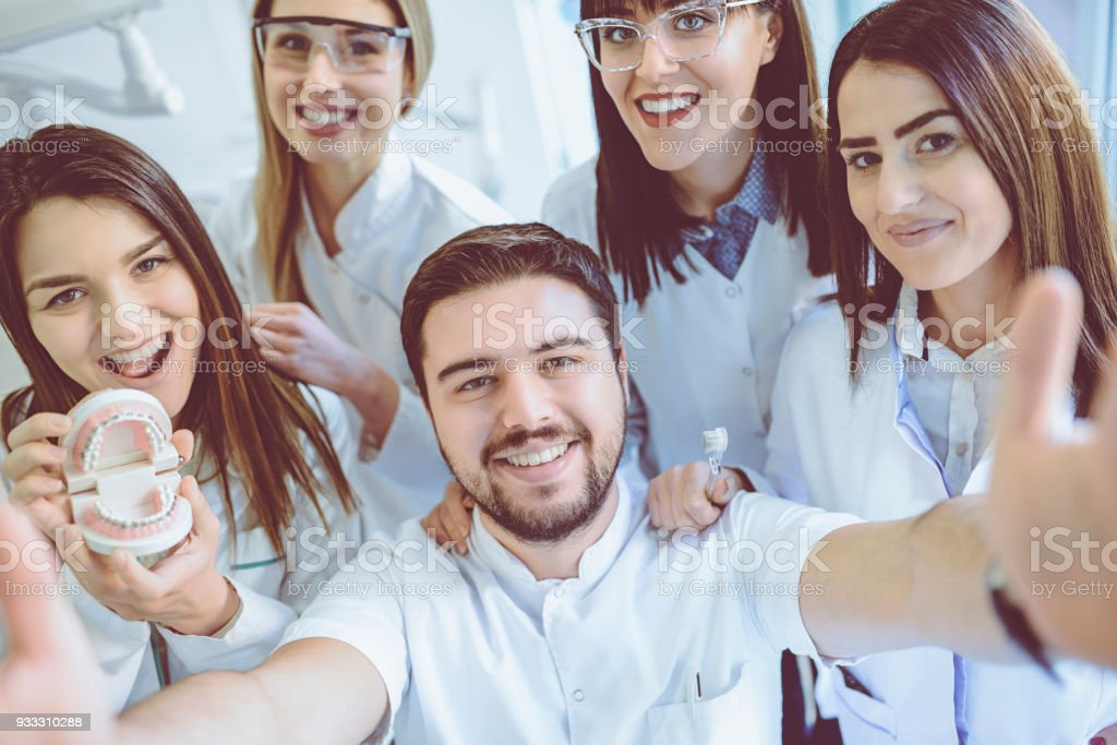 Group of Dentists Students Make Selfie in Clinic stock photo