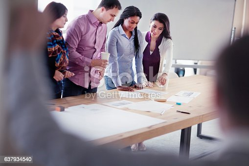 istock Group of designers collaborating in office studio 637934540