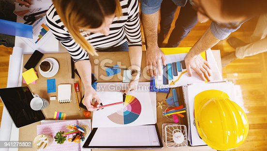 1068752548 istock photo Group of designers consulting in office at the working desk about colour in the project which has to be done. 941275802