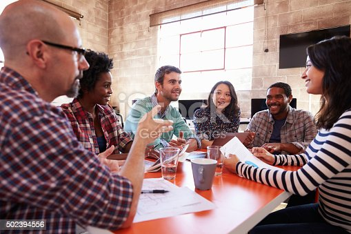 502281620 istock photo Group Of Designers Having Meeting Around Table In Office 502394556