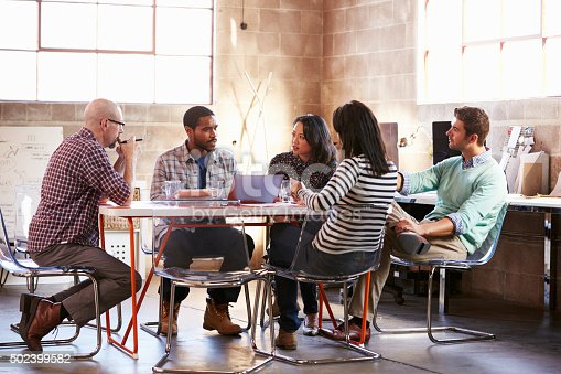 istock Group Of Designers Having Meeting Around Table In Office 502399582