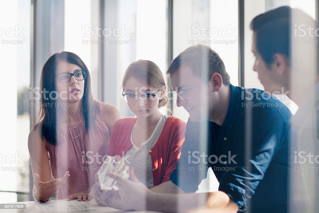 Group of designers planning together in studio stock photo