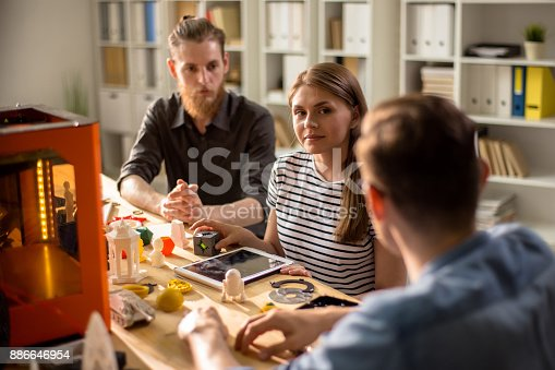 886646936 istock photo Group of Designers Working on 3D Project 886646954