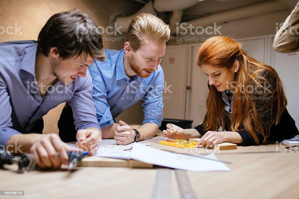 Group of designers working on a project royaltyfri bildbanksbilder