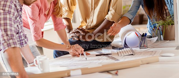 istock Group of designers working together 532578653