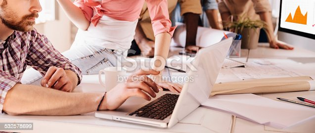 istock Group of designers working together 532578699