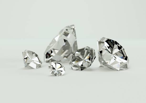 grupo de diamantes sobre fondo blanco. - brillante fotografías e imágenes de stock