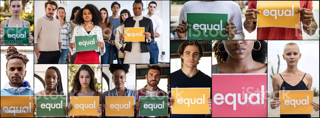 Group of different ethnicities people standing for equal rights and...