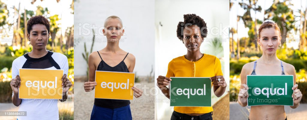Group of different ethnicities people standing for equal rights and justice stock photo