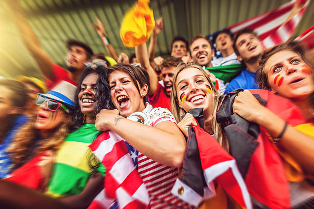 group of different nations supporters together - soccer competition stock photos and pictures