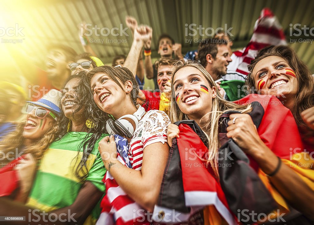 Group of different nations supporters together royalty-free stock photo