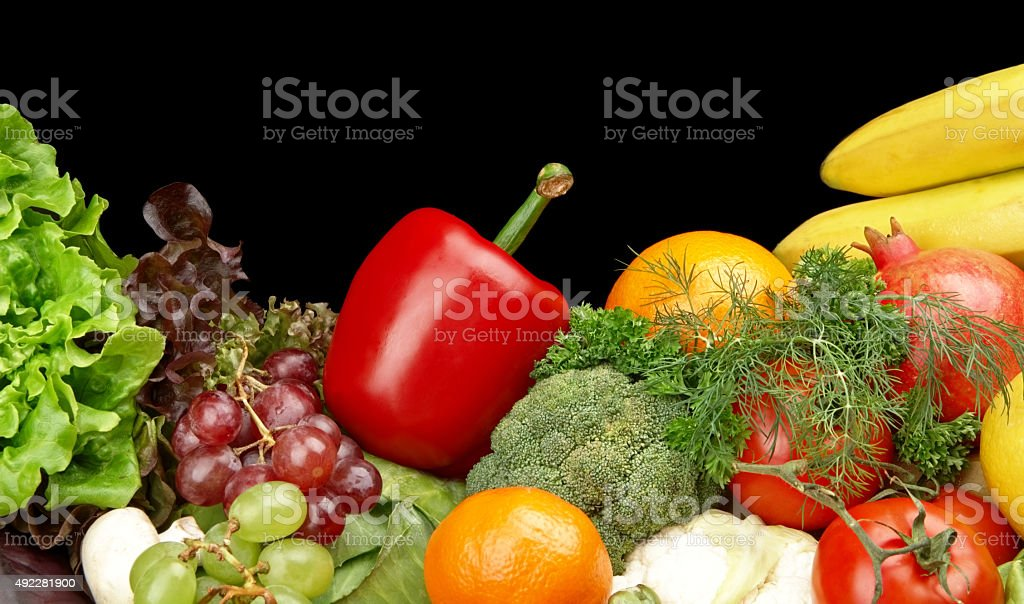 Group of different vegetables and fruits on black stock photo