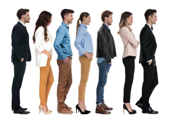 gruppe verschiedener jugendlicher wartet an der reihe - bräutigam jeans stock-fotos und bilder