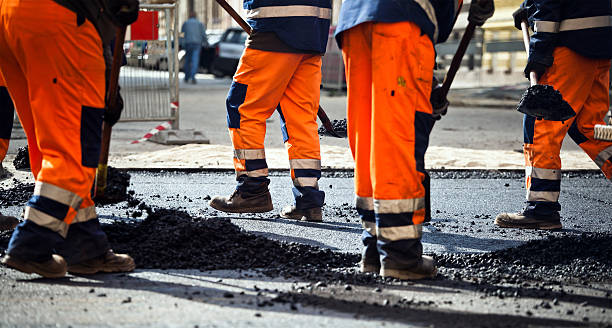 Group of dirty road construction workers stock photo