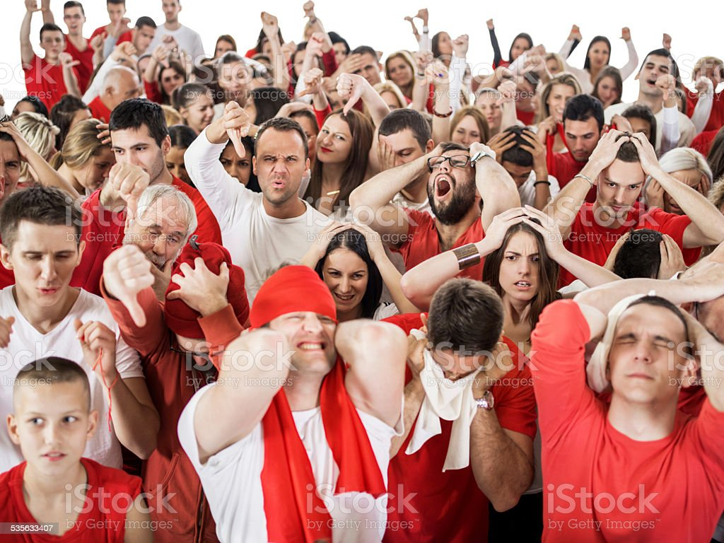 Group of disappointed fans. stock photo