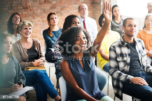 A group of diverse audience in a meeting