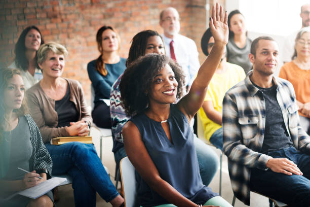 A group of diverse audience in a meeting stock photo