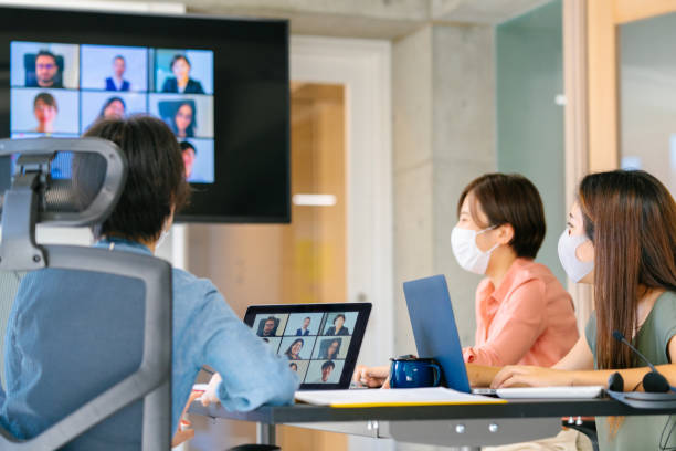 Group of diverse business people doing global business meeting via video conference call stock photo