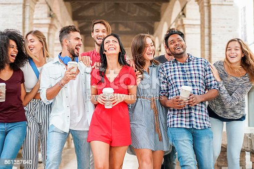 istock Group of diverse culture friends walking in city center with coffee paper cup - Happy people having fun together - Youth and friendship concept - Main focus on indian man 861387640