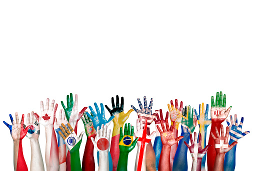 Group Of Diverse Flag Painted Hands Raised Stock Photo - Download Image Now