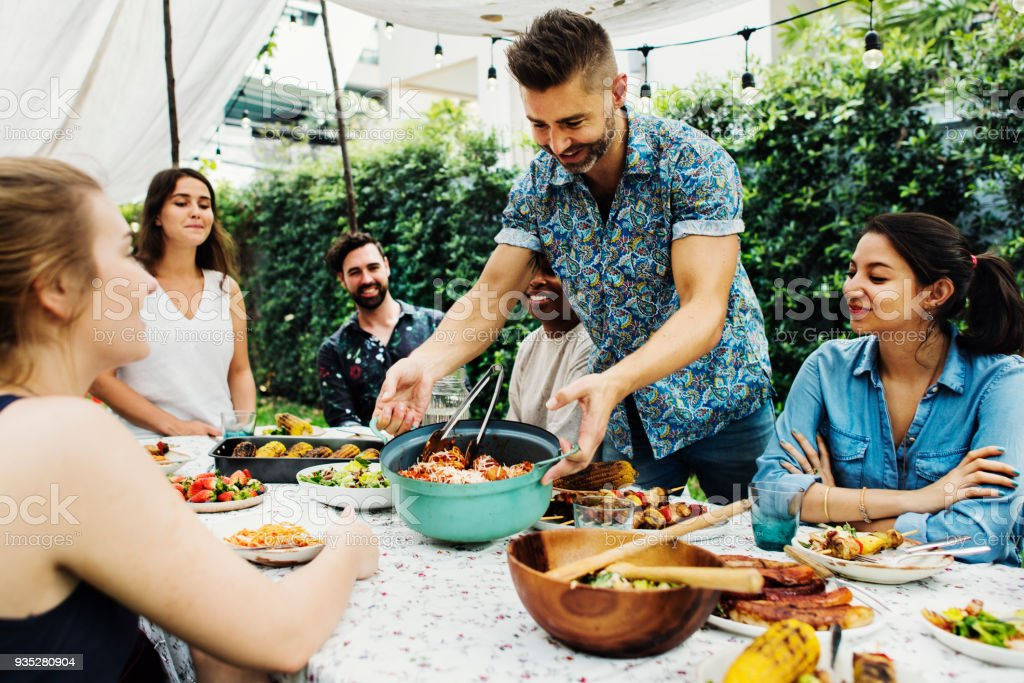 Group of diverse friends enjoying summer party together stock photo