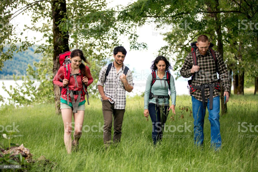 Group of diverse friends hiking stock photo