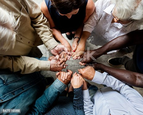 847516586 istock photo Group of diverse hands holding each other support together teamwork aerial view 847516586