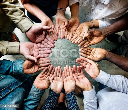 847516586 istock photo Group of diverse hands palms circle support together teamwork aerial view 847541546