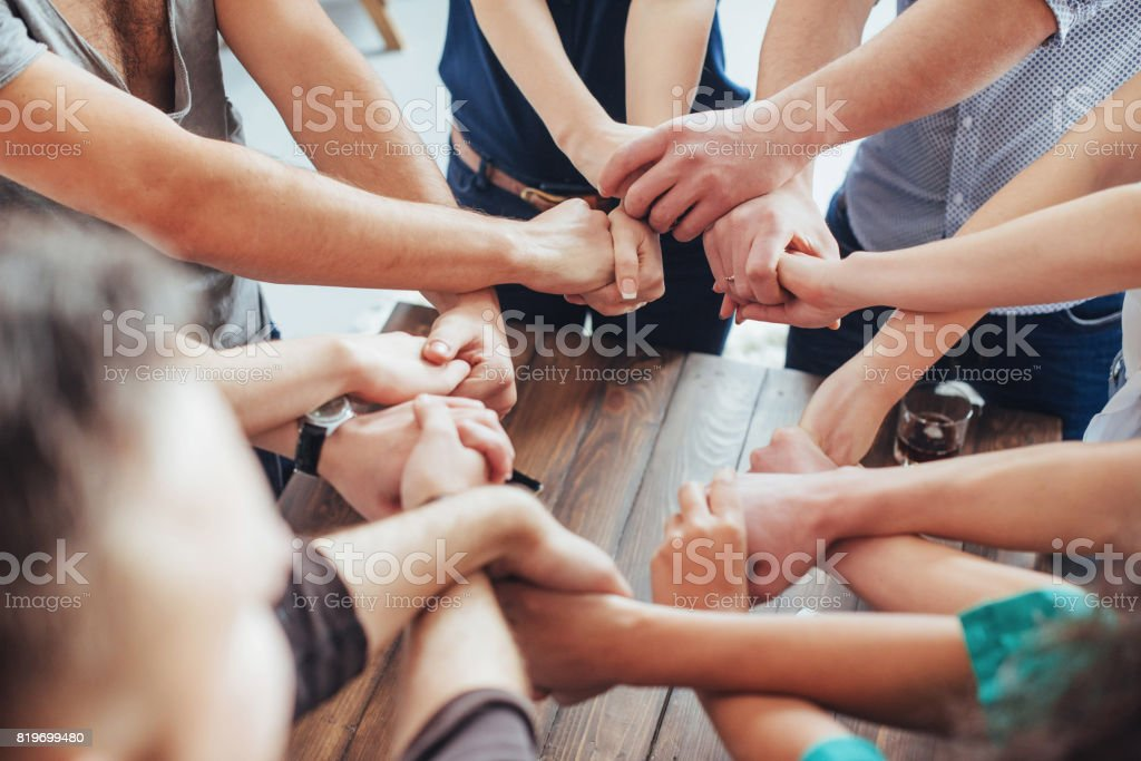 Group of Diverse Hands Together Joining. Concept  teamwork and friendship stock photo