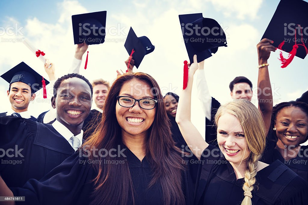Group of Diverse International Students Celebrating Graduation Group of Diverse International Students Celebrating Graduation Achievement Stock Photo