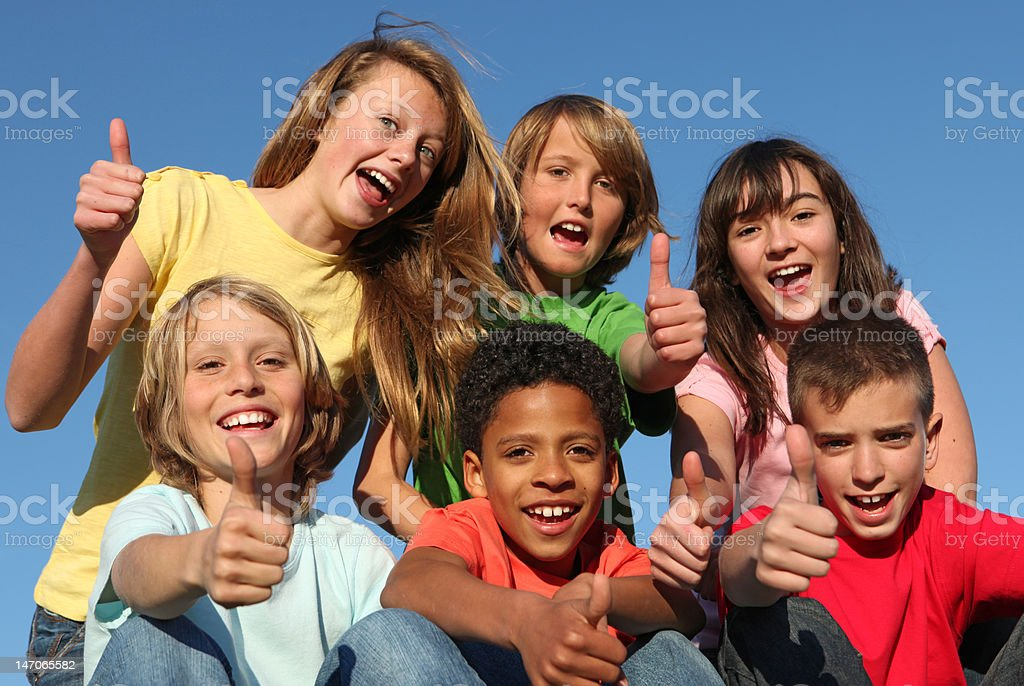group of diverse kids holding thumbs up stock photo