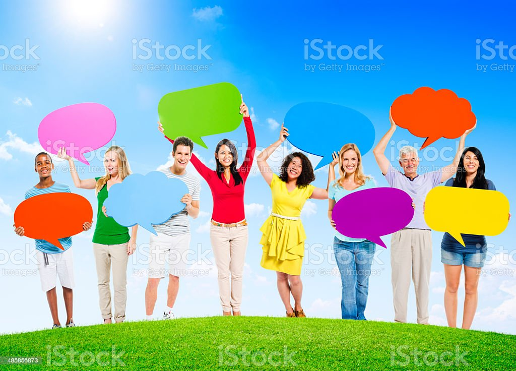 Group of Diverse Multi-Ethnic People Outdoors Holding Colorful S royalty-free stock photo