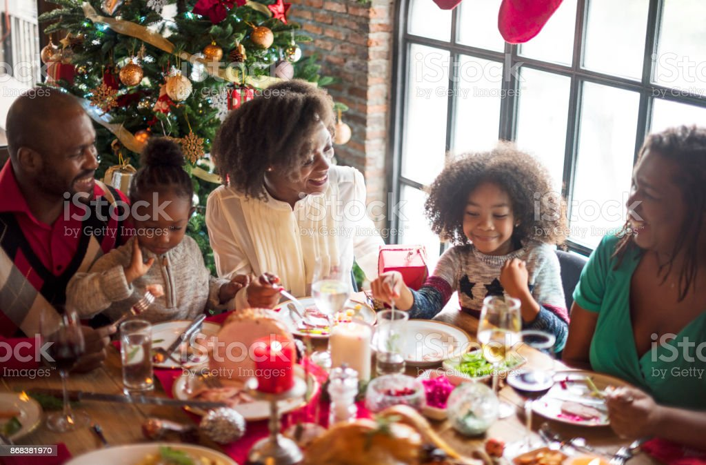 Group of diverse people are gathering for christmas holiday stock photo