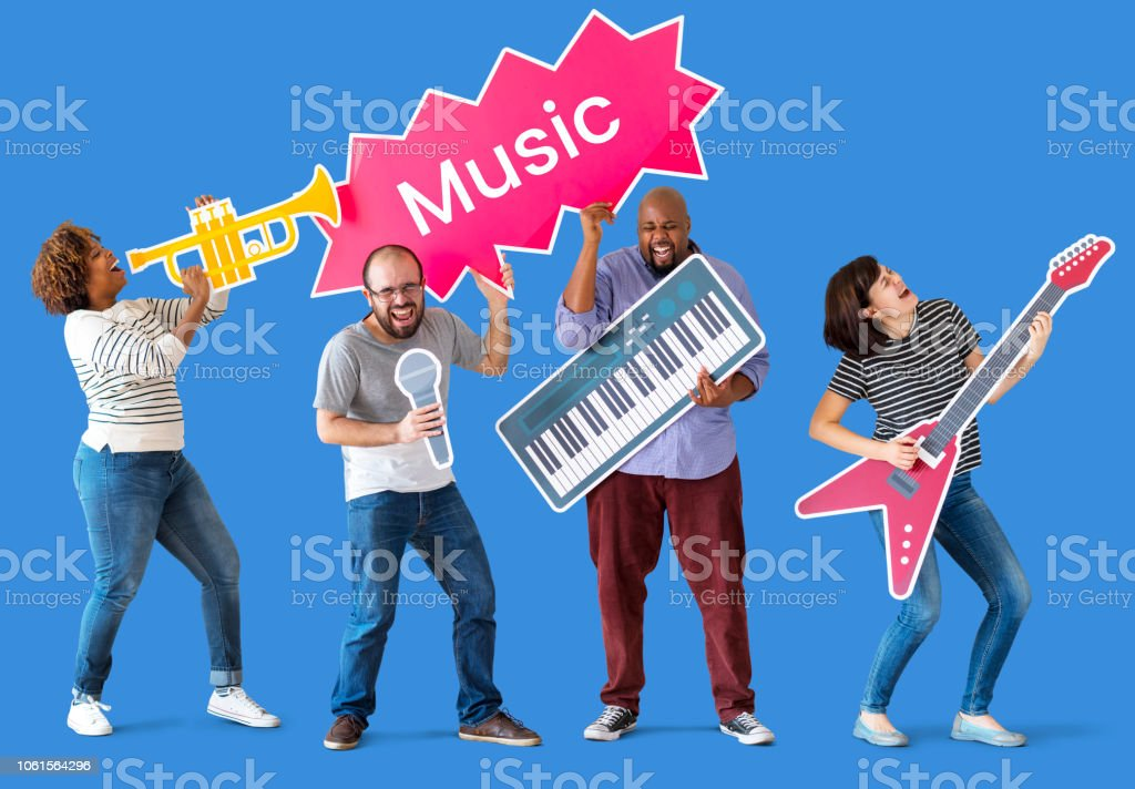 Group of diverse people enjoying music instruments stock photo