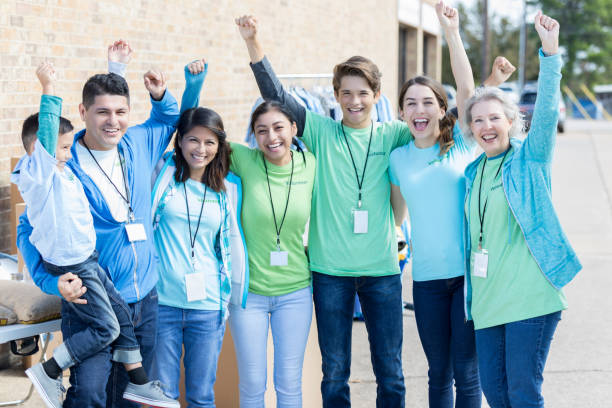 Group of diverse people volunteer at charity event stock photo