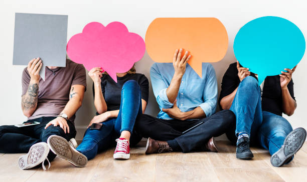 Group of diverse people with speech bubbles icons Group of diverse people with speech bubbles icons speech bubble stock pictures, royalty-free photos & images