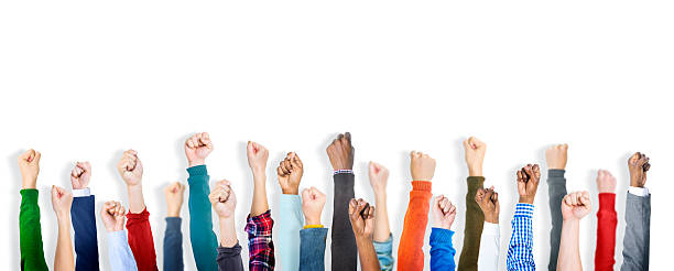 Group of Diverse People's Clenched Fists Group of Diverse People's Clenched Fists human rights stock pictures, royalty-free photos & images